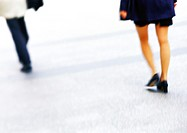 Businesswoman walking, low section