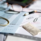 Paperwork, glasses and office materials lying on desk