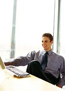 Businessman sitting at desk smiling