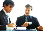 Businessmen working together with coffees