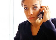 Businesswoman on cell phone, close up