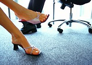 Businessman and businesswoman's feet