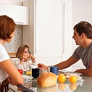 Mother and father with daughter at breakfast table