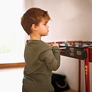 Young boy playing foosball