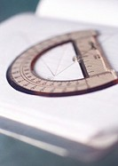 Semicircular protractor on notebook