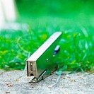 Stapler in grass