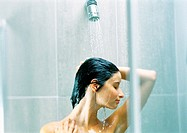 Woman taking shower, close-up