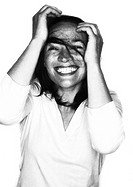 Woman laughing, hands on head, portrait, b&w