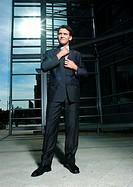 Businessman straightening necktie