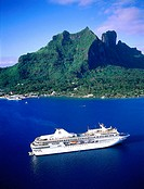 Aerial View of Bora Bora island and cruise ship at anchor in Lagoon ( MS Paul Gauguin). Leeward islands. French Polynesia