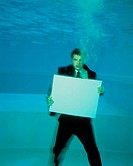 A man in a suit under the water