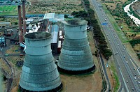 Cooling towers by a motorway