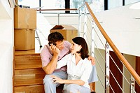 Young couple unpacking in their new house
