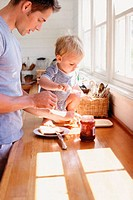 Father and child having breakfast