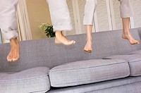 Feet bouncing on sofa (thumbnail)