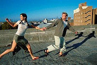 Couple running outdoors (thumbnail)