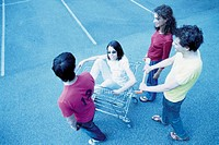 Teenagers with shopping trolley