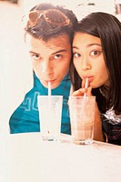 Couple drinking milkshakes