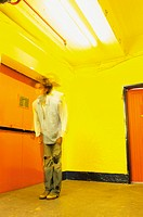 Man in yellow room