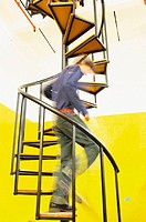 Man descending spiral stairs