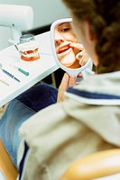 Girl examining her teeth