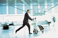 Businessman rushing in airport terminal
