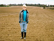 Woman standing in an empty field