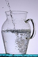 Water pouring into jug