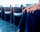 Man sitting in hospital waiting room (thumbnail)