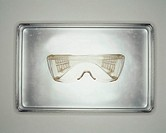 Safety goggles on metal tray