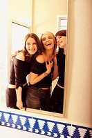 Women joking around in bathroom