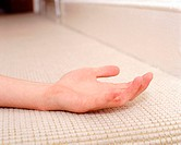 Hand on carpet