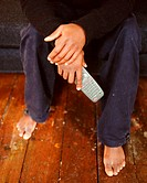 Man holding a remote control for digital TV