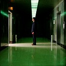 Man standing in empty corridor