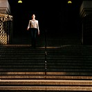 Woman walking down steps