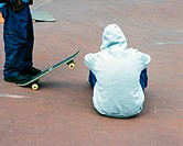 Teenagers in skateboard park