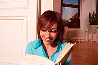 Young woman enjoying book