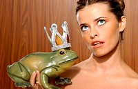 Woman holding toy frog (thumbnail)