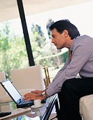 Businessman Working from Home on Laptop