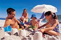 Family Making Sandcastles on the Beach