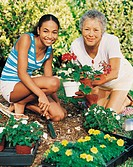 Portrait of a Grandmother and Her Granddaughter Gardening