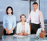 Portrait of Three Business Executives By a Desk