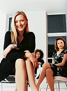 Portrait of a Small Group of Businesswomen Sitting in a Modern Office