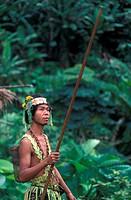An Orang Asli man using a blowpipe, Malaysia
