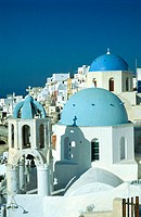 Blue Church belfry and cupolas. Ia village. Santorini (Cyclades). Greece