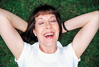 Portrait of a woman lying on a lawn (thumbnail)