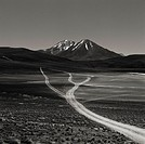 Black and white image of trackway with mountains in the background (thumbnail)