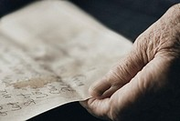 Mature woman reading a letter (thumbnail)