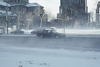 Traffic on snowy, windswept road (thumbnail)