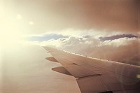 Looking out port side over an aircraft wing tip (thumbnail)